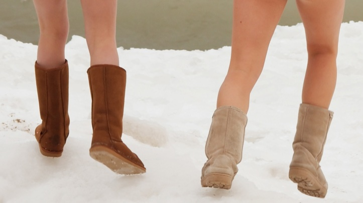 "Two young women ""Uggstep"" through snow."